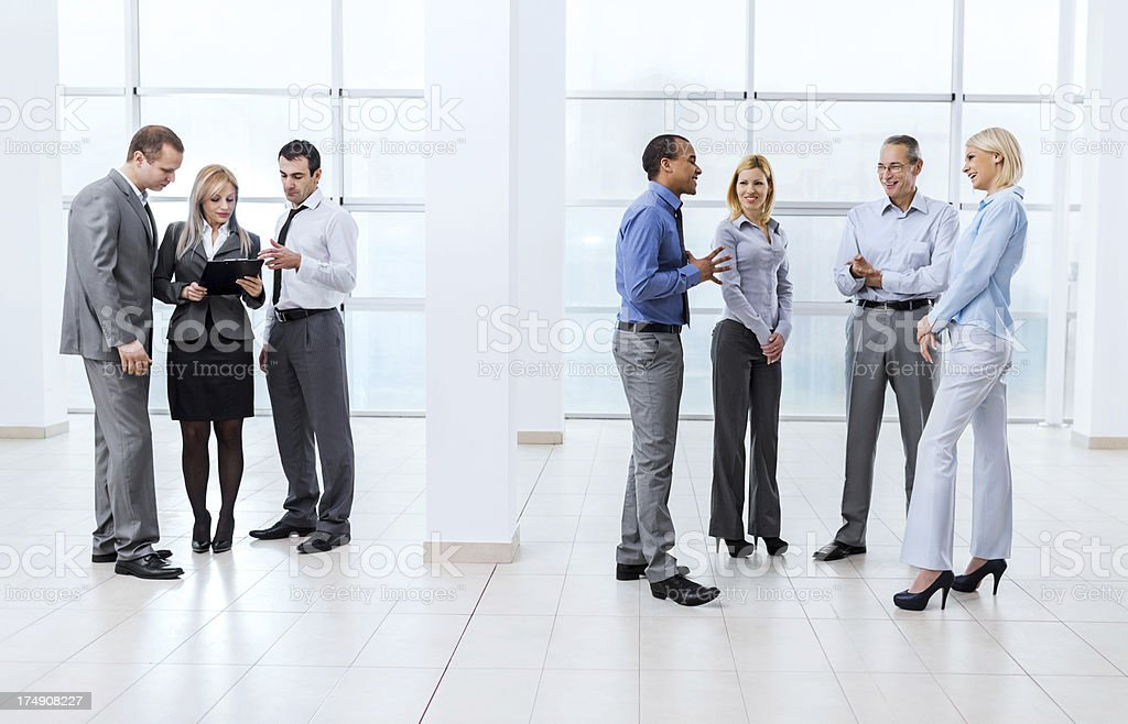 Group of successful businesspeople standing and talking. royalty-free stock photo