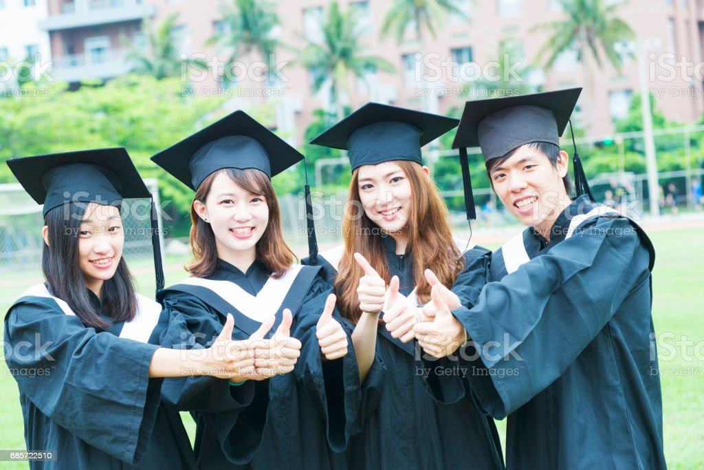 Group of successful students on their graduation day royalty-free stock photo
