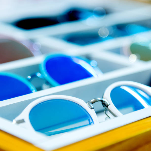 group of sunglasses in shop - sale lenses stock photos and pictures