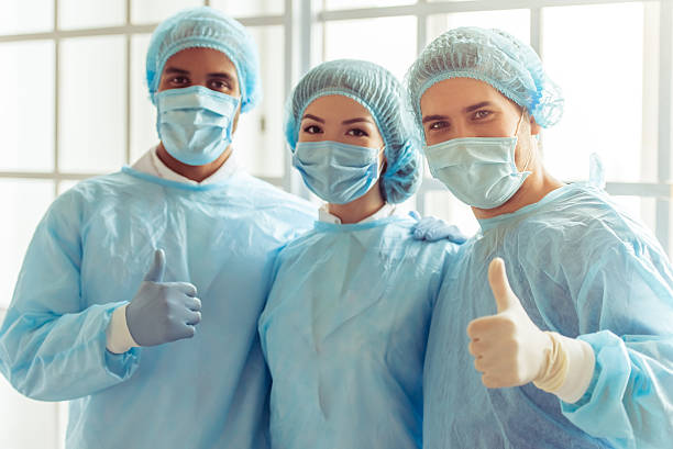 Group of surgeons stock photo