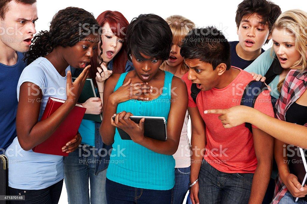 Group of surprised students looking result on a tablet PC royalty-free stock photo