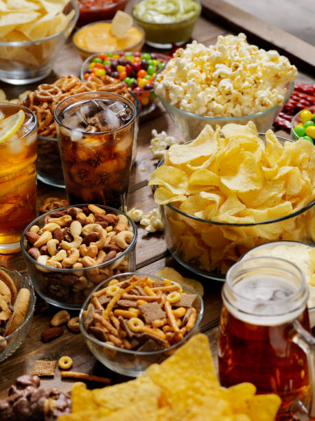 Group of Sweet and Salty Snacks, Perfect for Binge Watching Group of Sweet and Salty Snacks, Perfect for Binge Watching unhealthy eating stock pictures, royalty-free photos & images