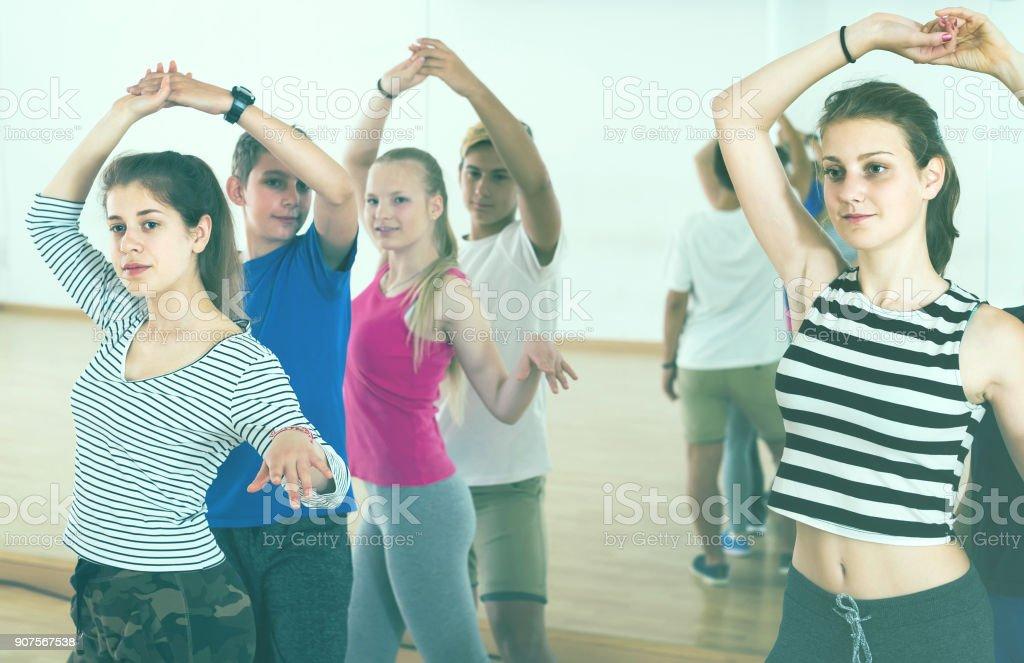 Group of teen dancing salsa in dance studio stock photo