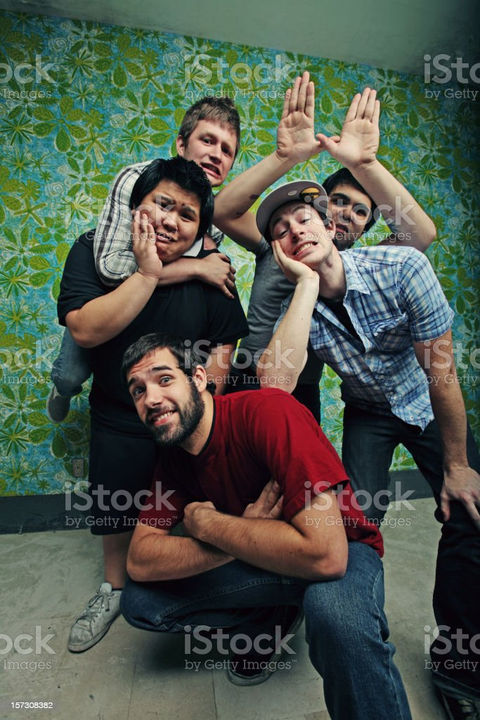 Group of Teen Men on Blue Green Wall royalty-free stock photo