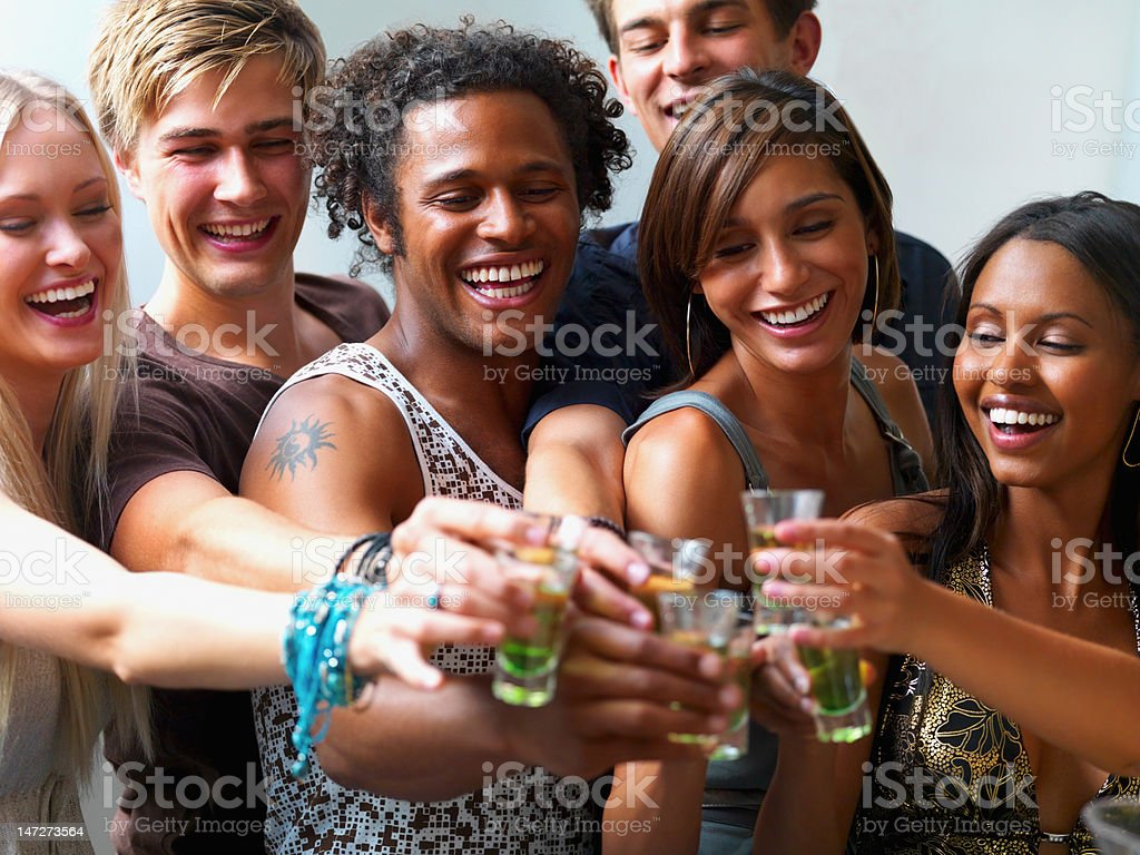 Group of teenage boys and girls toasting wine royalty-free stock photo