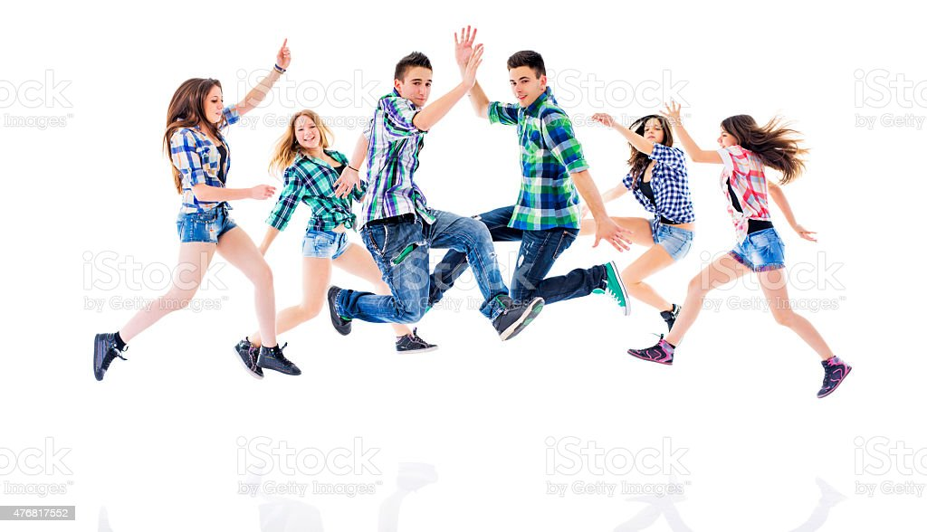 Group of teenage dancers jumping and exercising. stock photo