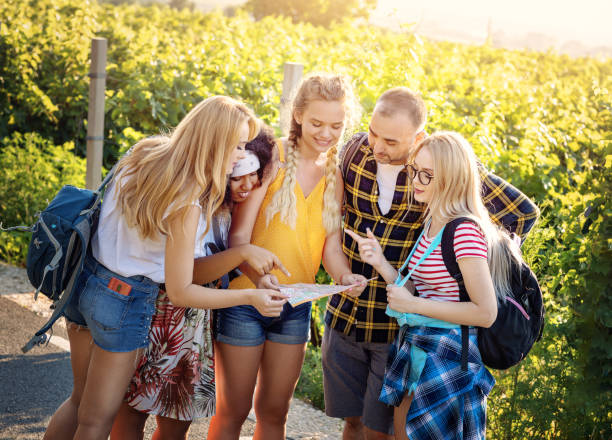 Group of teenage friends enjoying summer discovering new locations looking at map stock photo