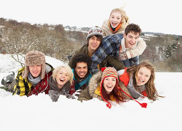 Group Of Teenage Friends Having Fun In Snowy Landscape stock photo