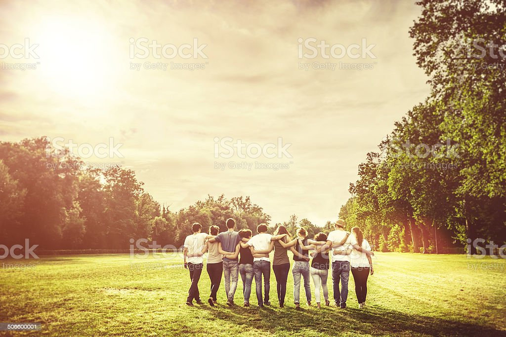 Group of Teenage Friends in the Park at Sunset stock photo