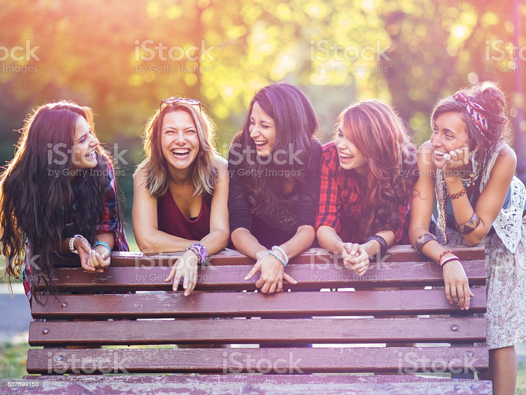 Group of teenage girls in the park stock photo