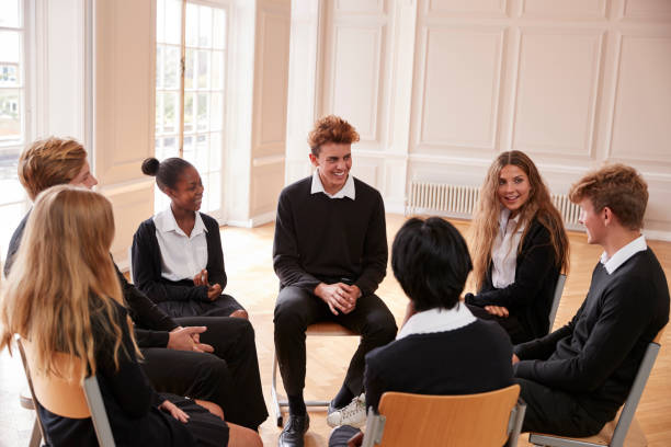 group of teenage students having discussion in class together - debate стоковые фото и изображения