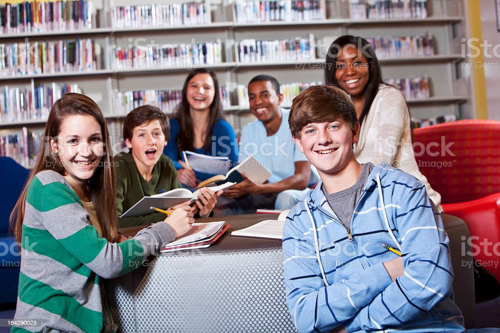 Group of teenage students in school library royalty-free stock photo