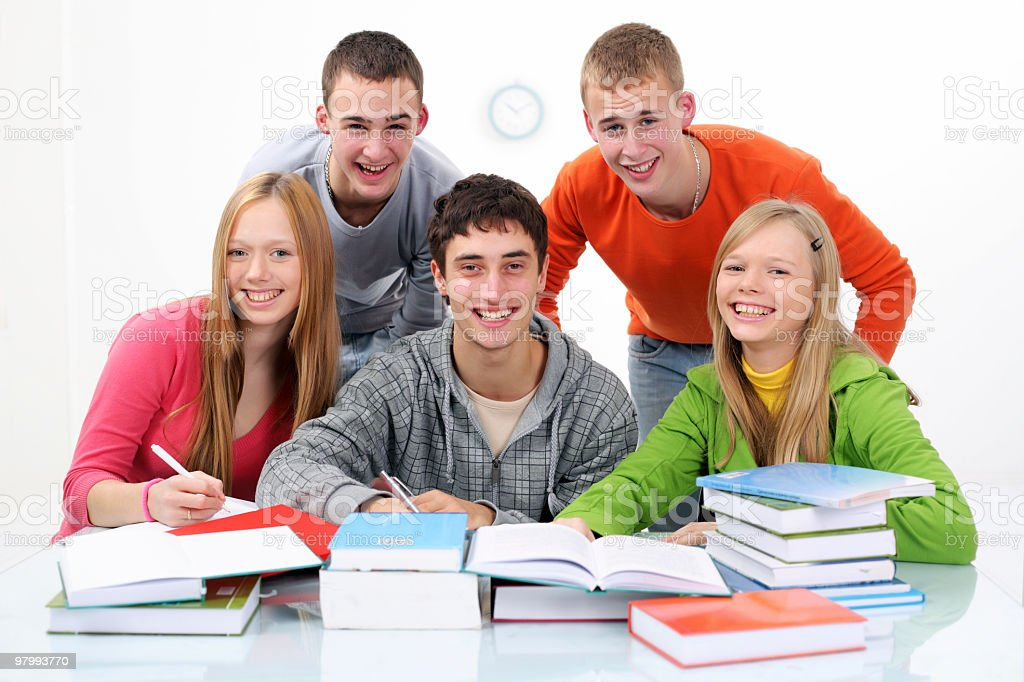 Group of teenage students studying together royalty-free stock photo