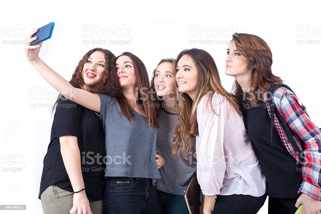 Group of teenage women making selfie stock photo