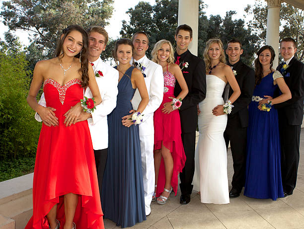group of teenagers at prom posing - prom stock photos and pictures