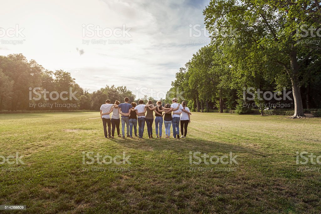 Group of teenagers at the park at sunset stock photo