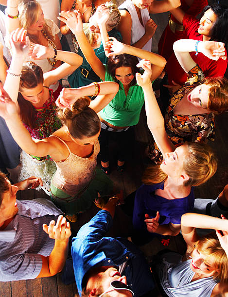 group of teenagers enjoying party at disco - dance floor stock photos and pictures