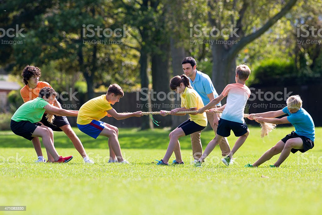 Group of Teenagers Having a Game of Tug-of-War stock photo