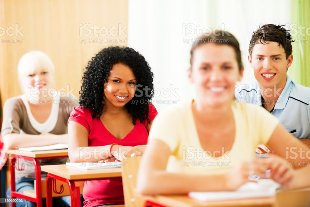 Group of teenagers students sitting in classroom. royalty-free stock photo
