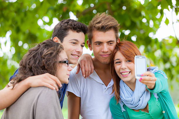 group of teenagers taking photos with mobile - beautiful college girl pics stock photos and pictures