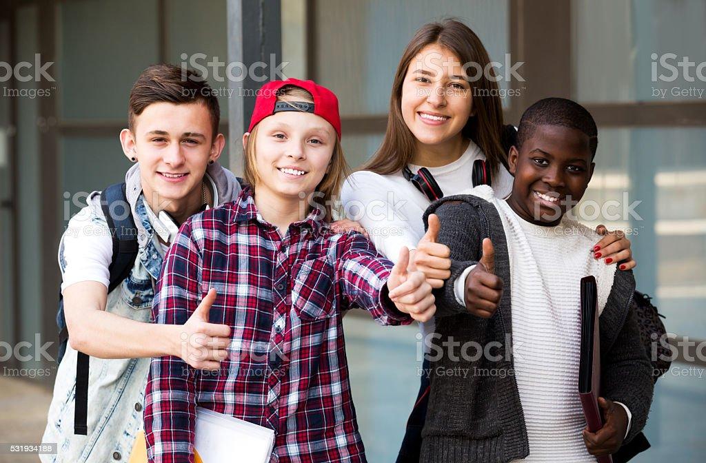 Group of teens posing outside school stock photo