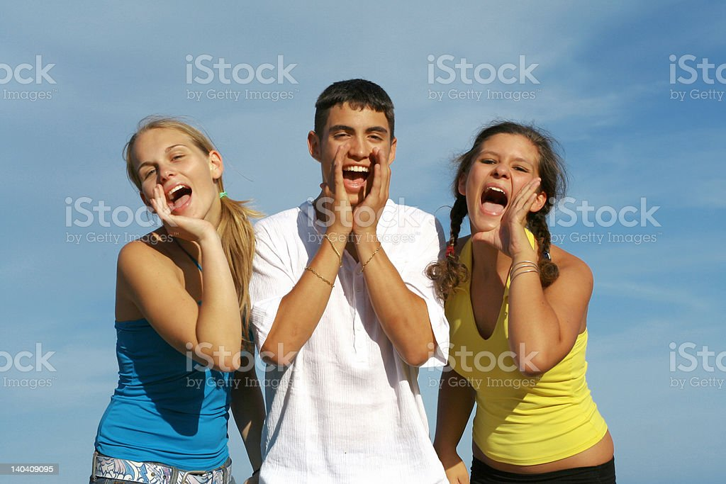 group of teens shouting stock photo