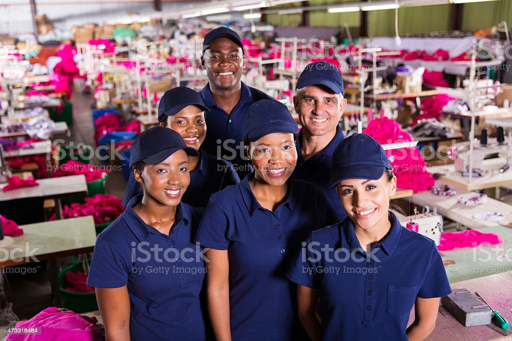 group of textile factory workers stock photo
