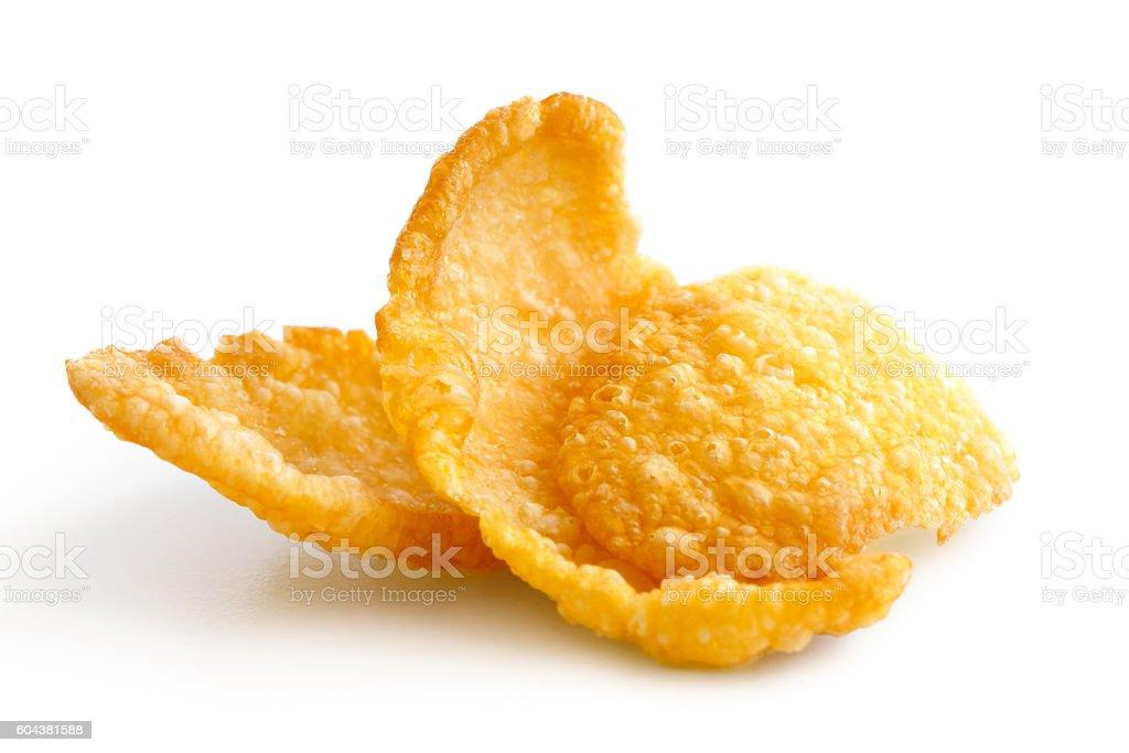 Group of three cornflakes isolated on white. stock photo