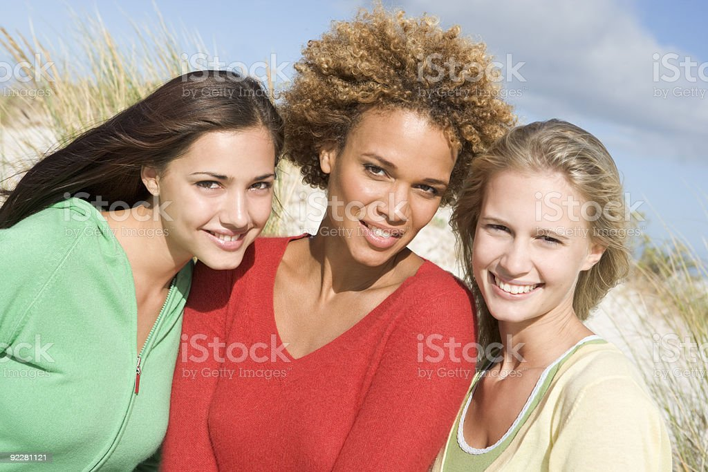 Group of three female friends at beach royalty-free stock photo
