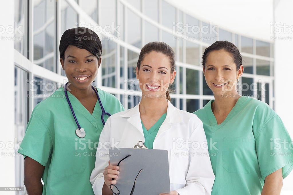 Group of three female medical professionals stock photo