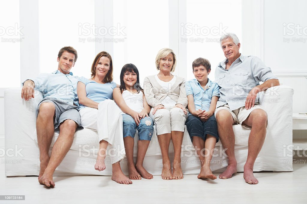 Group Of Three Generations Of Family Sitting On A Sofa Royalty Free Stock  Photo