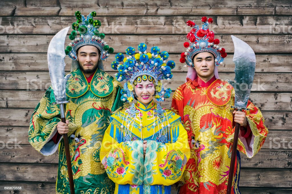 group of three people chinese men and woman in traditional costumes with swords greeting guests against  sc 1 st  iStock & Group Of Three People Chinese Men And Woman In Traditional Costumes ...