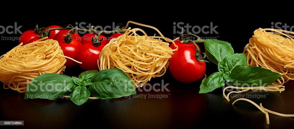 Group of three round balls of raw pasta on black stock photo