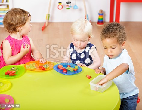 Group of toddlers having a healthy snack in a nursery setting.Nikon D3X. Converted from RAW.