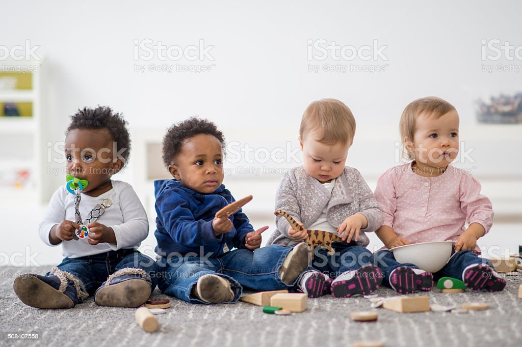 Group of Toddlers Playing Together stock photo