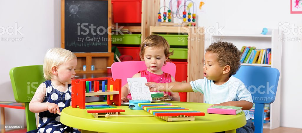 Group Of Toddlers Reading stock photo