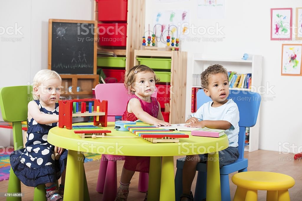 Group Of Toddlers Reading/ Playing With Xylophones stock photo