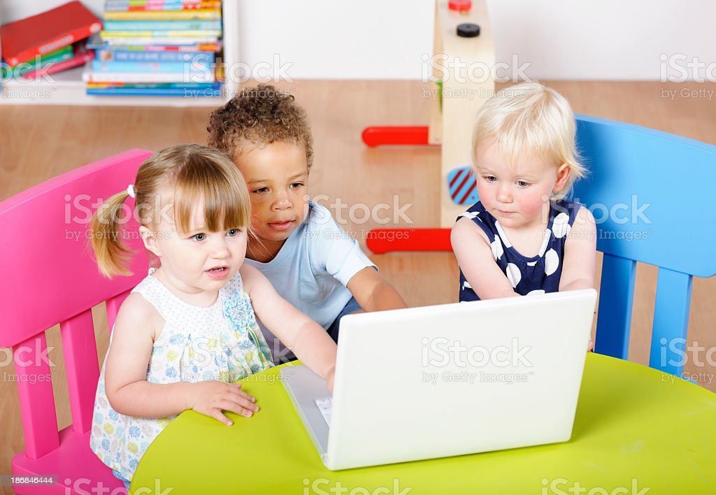 Group Of Toddlers Using  Technology In A Nursery Setting royalty-free stock photo