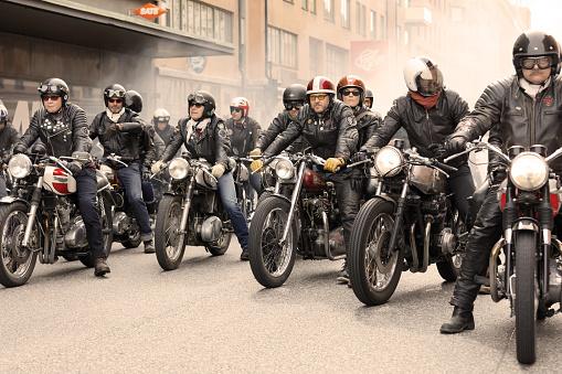 STOCKHOLM, SWEDEN - SEPT 02, 2017: Group of tough bikers in leather clothes on retro motorcycles at the Mods vs Rockers event at the Saint Eriks bridge, Stockholm, Sweden, September 02, 2017