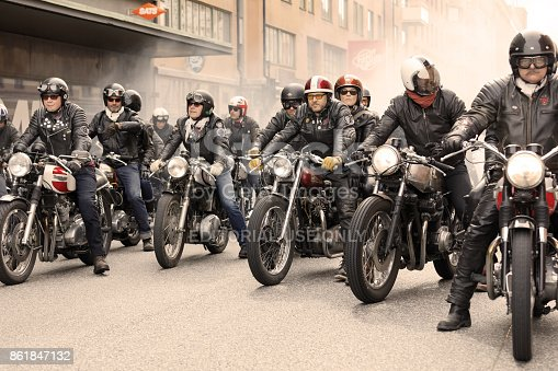 STOCKHOLM, SWEDEN - SEPT 02, 2017: Group of tough bikers in leather clothes on retro motorcycles at the Mods vs Rockers event at the Saint Eriks bridge, Stockholm, Sweden, September 02, 2017