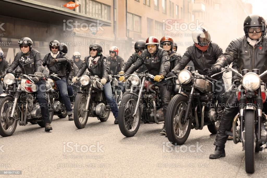 Group of tough bikers in leather clothes on retro motorcycles at the Mods vs Rockers event stock photo