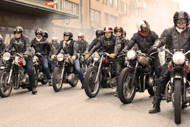 group of tough bikers in leather clothes on retro motorcycles at the mods vs rockers event - biker stock photos and pictures