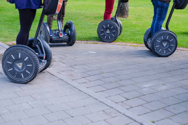 Group of tourist riding segway in the city stock photo