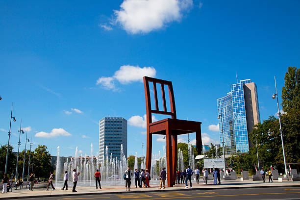 "Group of tourists in the ""Broken Chair"" Monument, Geneve"