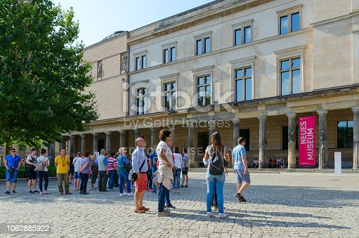 istock Group of tourists is at New Museum building on famous Museum Island, Berlin, Germany 1062885922