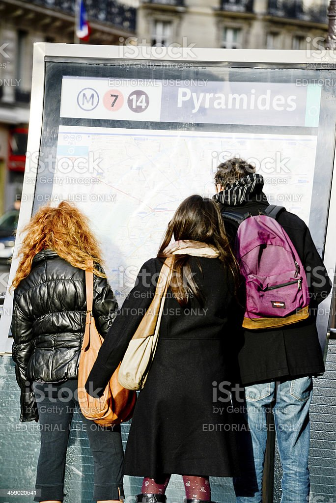 Map Of France For Tourists.Group Of Tourists Looking At City Map Paris France Stock Photo