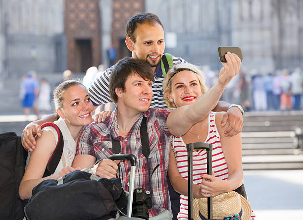 Group of tourists making selfie stock photo