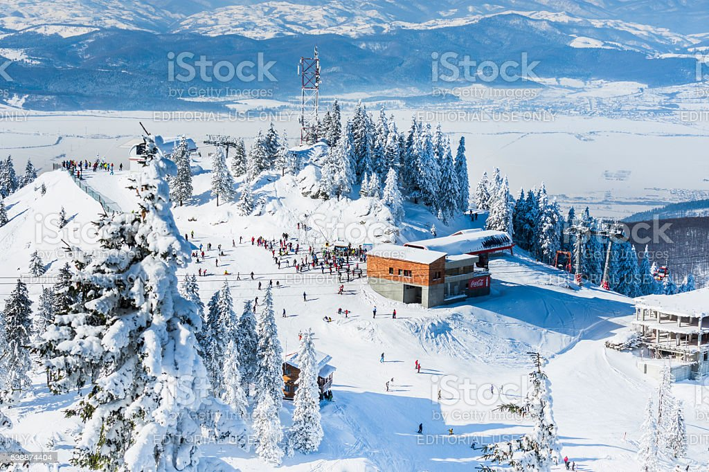Group of tourists on a ski slope stock photo