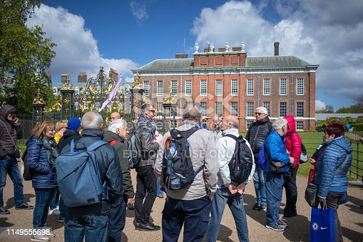 4th May 2019 - Group of tourists outside Kensington Palace in London UK. The once home of Prince Charles and Princess Diana after their wedding