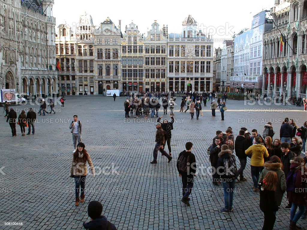 Group Of Tourists Standing,Walking,Looking Around At Grand Place.Brussels.Belgium.Europe stock photo